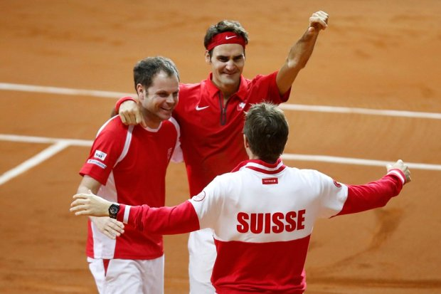 Switzerland's Federer and team captain Luthi celebrate after he defeated France's Richard Gasquet during their Davis Cup final singles tennis match at the Pierre-Mauroy stadium in Villeneuve d'Ascq