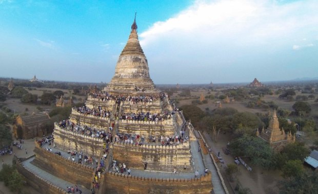 People wait to see the sunset from the top of Shwesandaw Pagoda in the ancient city of Bagan